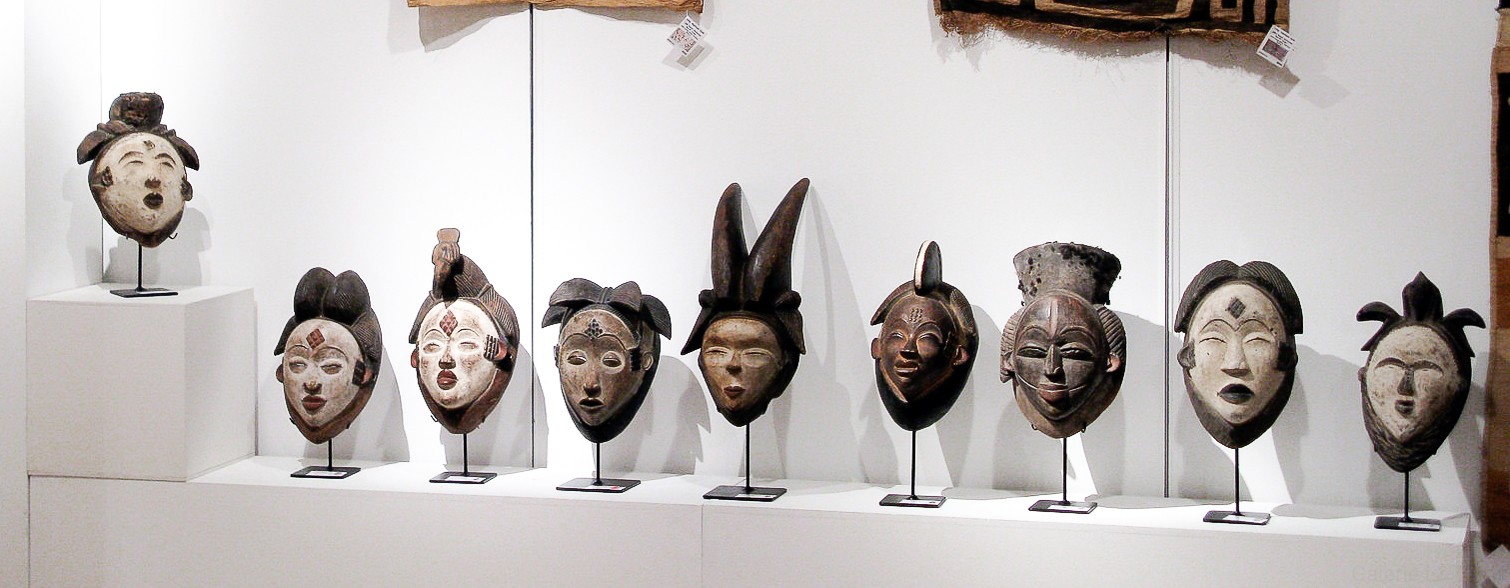 African Punu masks: Ikwara, Pumbu or Phumbu, Okuyi with a white face. Authentic objects of primitive art offered by a gallery